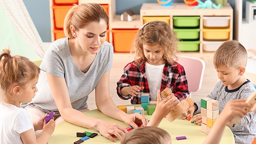 children playing in a secure nursery with Badgy identification badges
